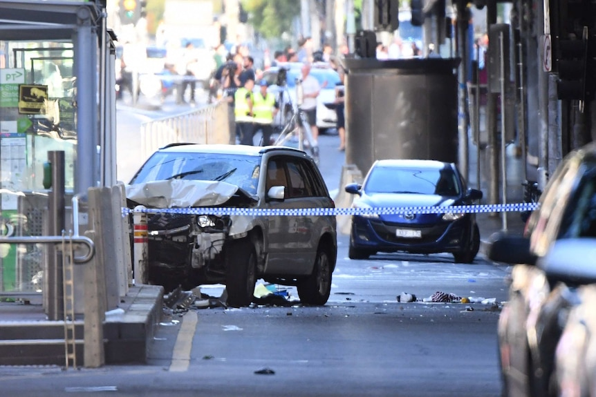 A damaged vehicle is seen on Flinders Street, in Melbourne.