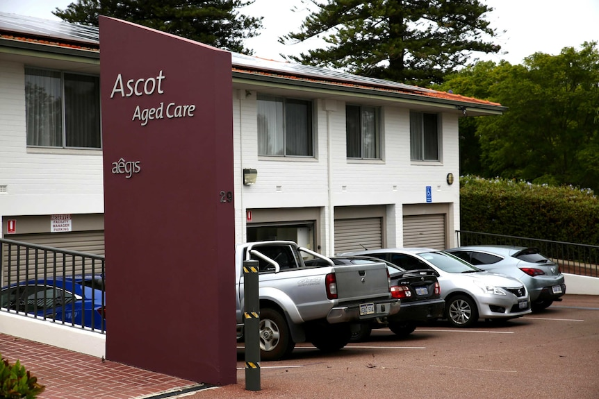 """A sign outside a brick building that reads """"Ascot aged care""""."""