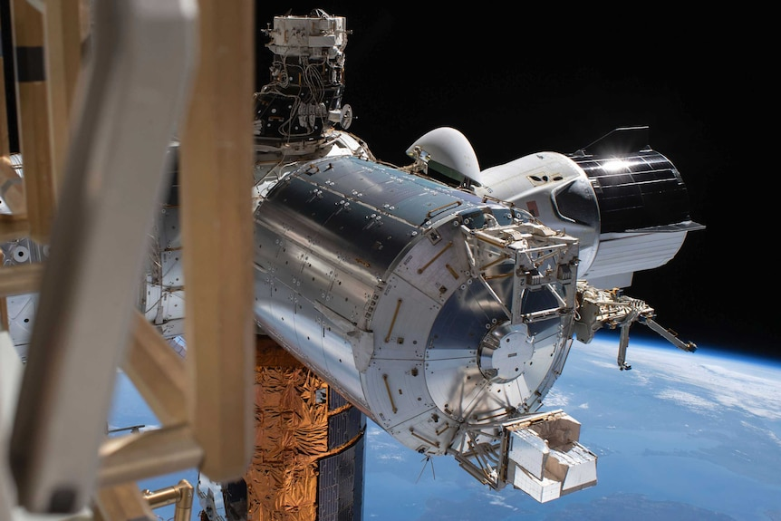 A SpaceX capsule docked with the International Space Station.