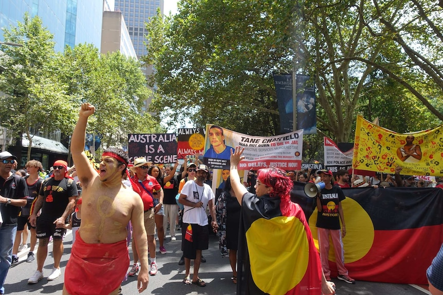 Invasion Day protesters march through Sydney.