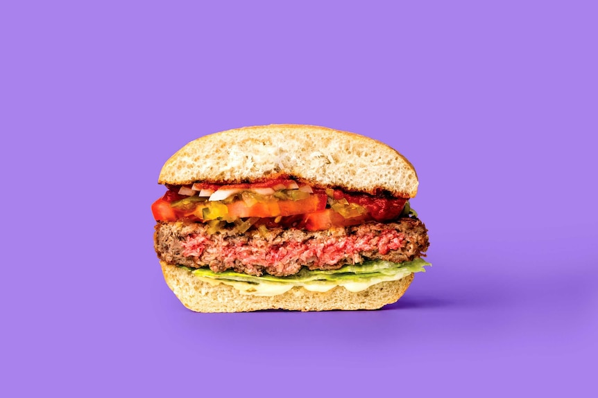 A close-up shot of a burger with a 'meat' patty that has a pink centre.