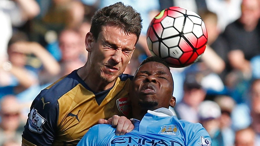 Arsenal's Laurent Koscielny goes for a header with Manchester City's Kelechi Iheanacho in May 2016.