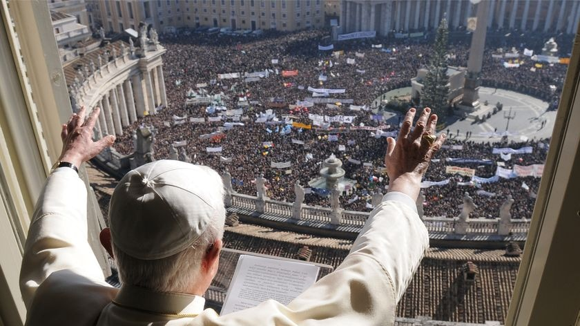 Pope Benedict XVI greets a crowd attending his weekly Angelus prayer