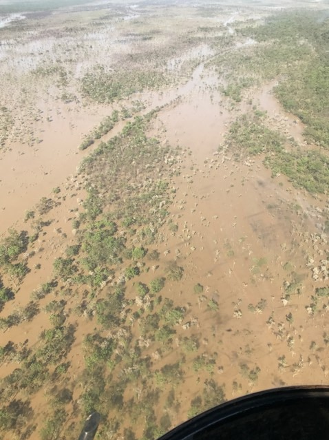 Aerial photo of floodwaters covering part of Strathmay Station, in Cape York.