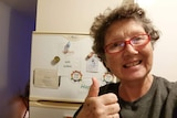 Ms O'Connor takes a selfie in front of her donated fridge.