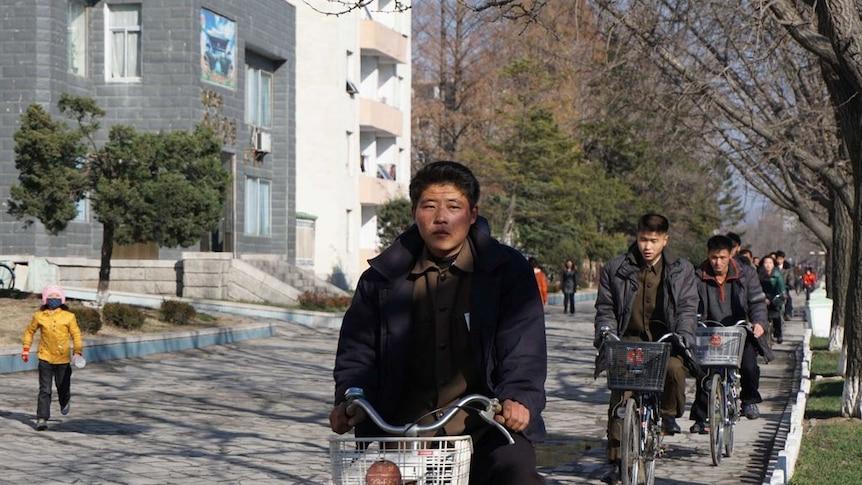 Citizens of North Korea bike riding from Pyongyang (Picture: Vicky Xiuzhong Xu)