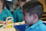 A young boy cries during his first day of kindergarten at Palmerston District Primary School in Canberra.