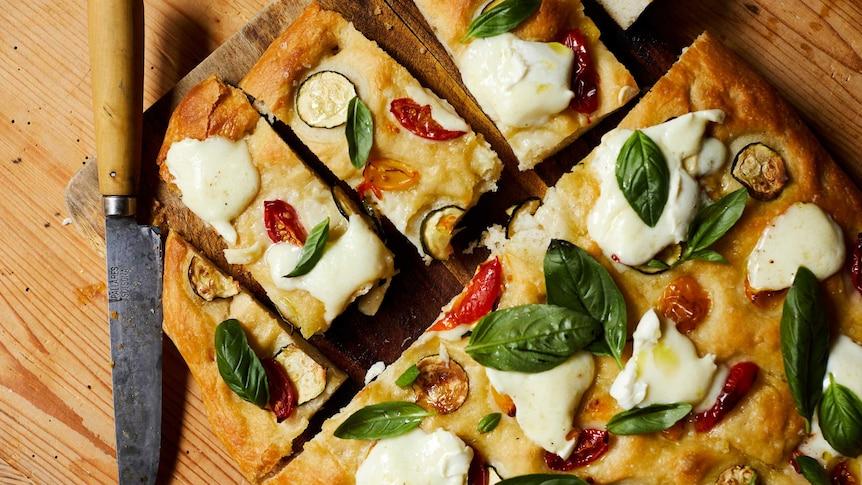 Cooked zucchini and cherry tomato focaccia, a recipe by Julia Busuttil Nishimura.