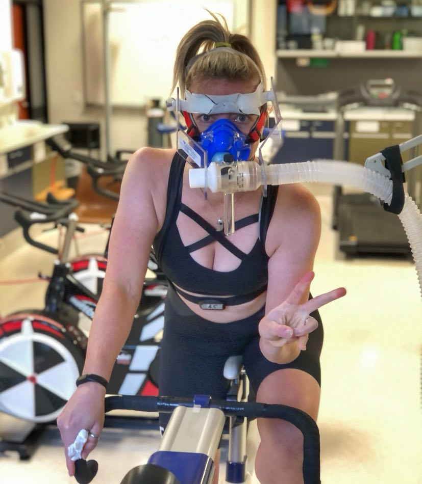Woman on a bike with an oxygen mask on