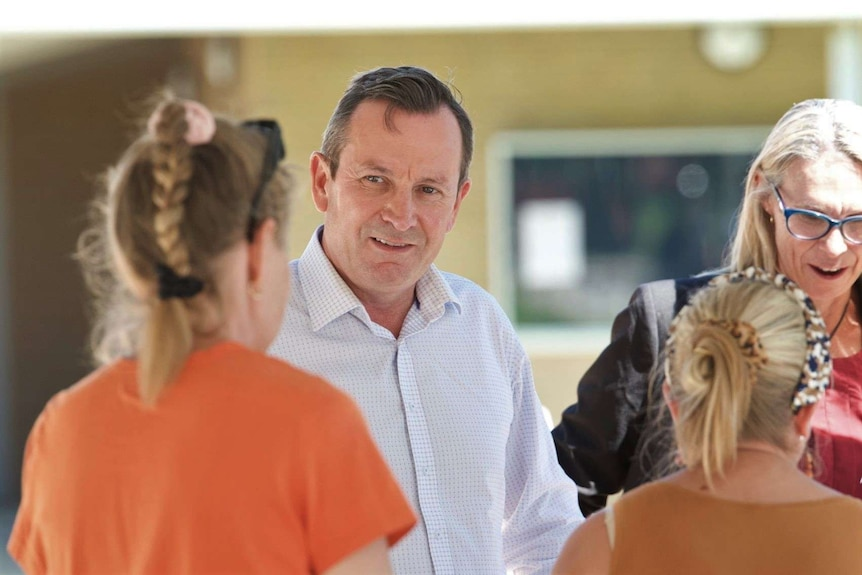 Premier Mark McGowan talks with voters in a final campaign stop in Zac Kirkup's ultra-marginal seat of Dawesville.