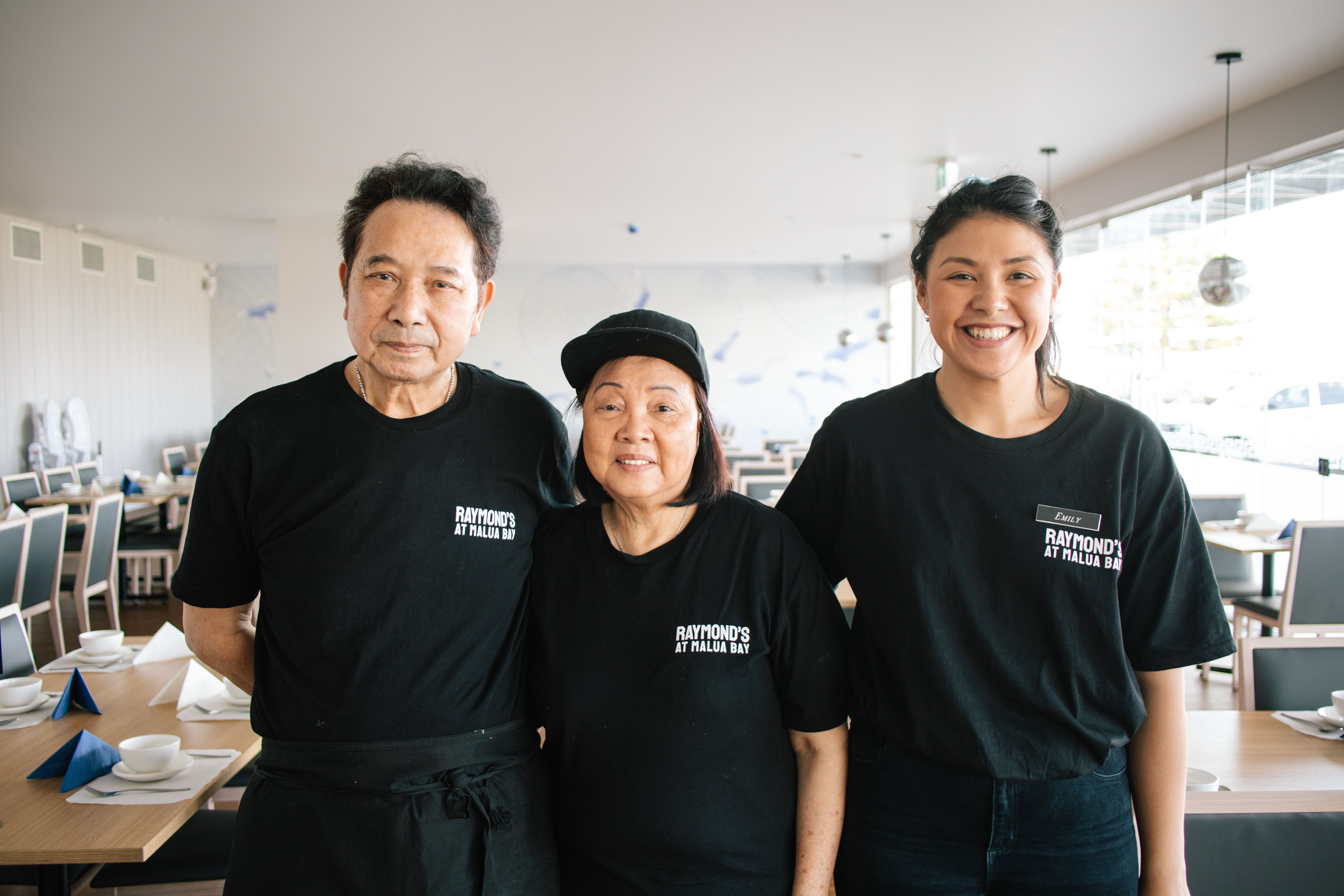 Raymond and Susie Ng with daughter Emily in their new restaurant, Raymond's at Malua Bay.