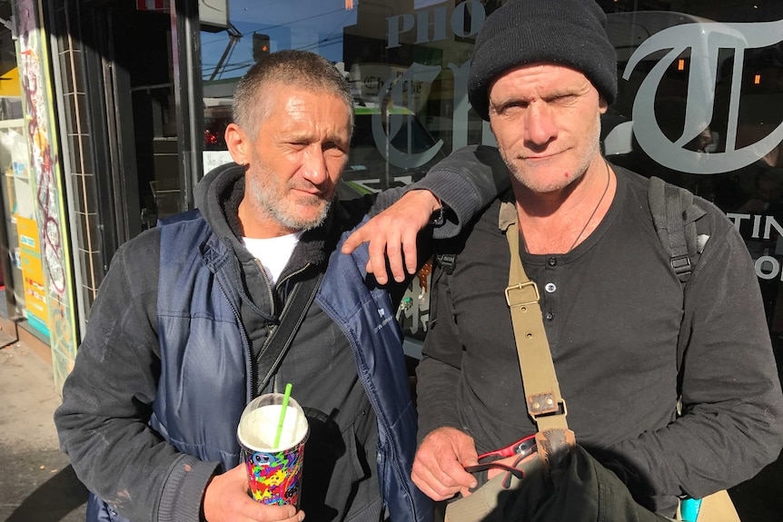 Welfare recipient Dutchie, who stands next to another man, says drug tests would force him to become a drug dealer.