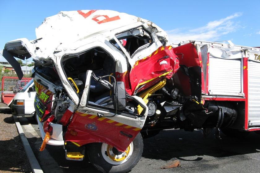 The Tasmanian fire truck damaged in collision with a semi-trailer.