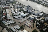 Rebuilding: the January floods inundated homes and businesses across Brisbane.