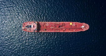 A tanker at sea as viewed from above.