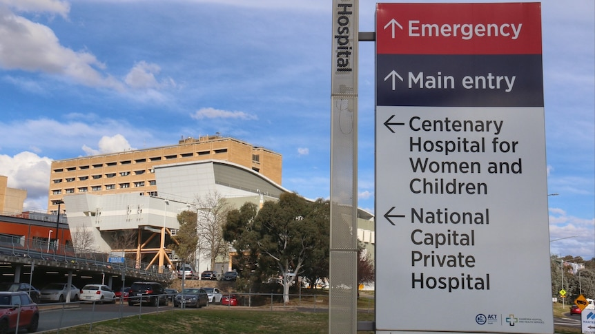 A sign directing to the emergency department in front of a hospital.