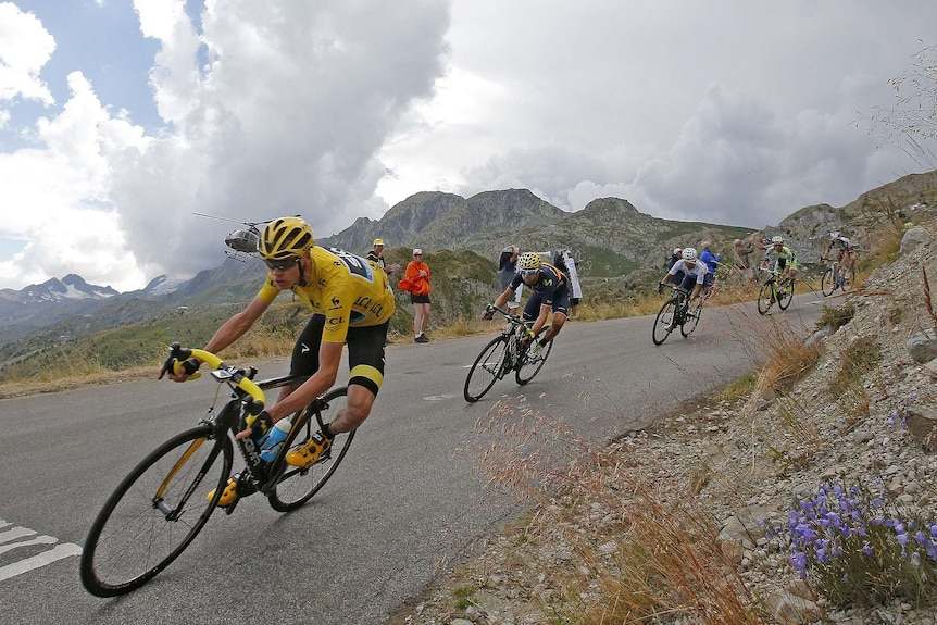 British rider Chris Froome leads the field through a sharp turn on a steep descent during the 2018 Tour de France