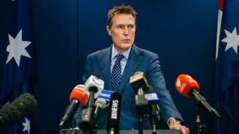 Christian Porter stands at a podium during a press conference in Perth.