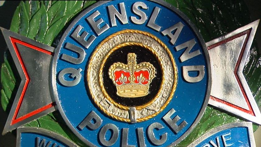 TV still of Qld Police emblem sign logo on an office wall
