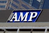 An AMP sign is displayed on a building in the Sydney central business district.