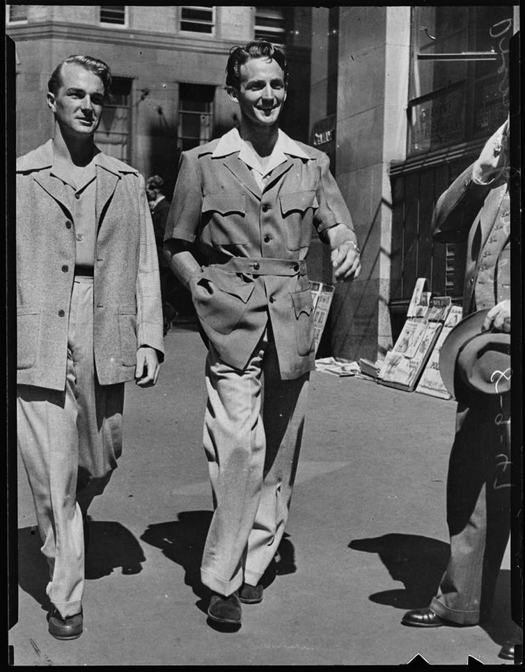 Two men wearing more relaxed suits