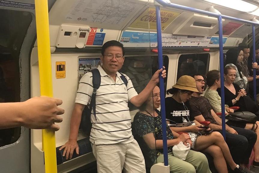 Chau Van Kham rides the London Underground during a visit to the UK last year.