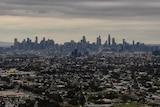 A view of Melbourne's CBD skyline, under hazy grey skies.