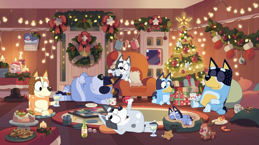 Bluey and family lie around the Christmas tree contentedly with decorations everywhere.