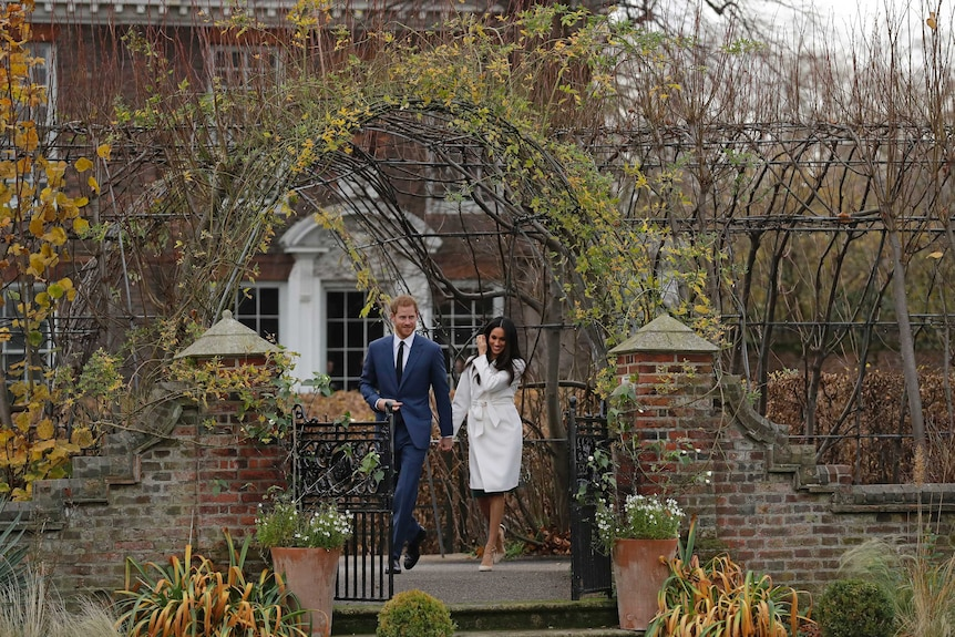Britain'sPrinceHarryand his fiancee Meghan Markle in the grounds of Kensington Palace.