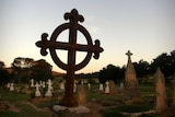 A rural graveyard at sunset.