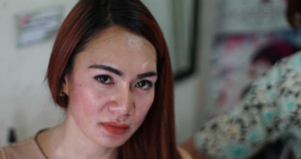 An image of a Indonesian transgender woman looking at the camera.