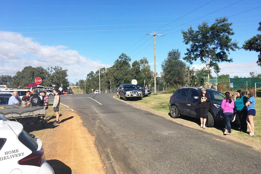 Residents wait near road blocks to get home as the siege with the gunman continues