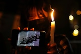 People light candle to mark the anniversary of the military crackdown on a pro-democracy student movement in Beijing