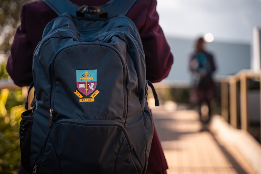 Close up of a Cardijn College school backpack.