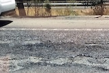 Melted road with a car on it.