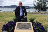 Peter Rezek inspects the new plaques dedicated to the Tasman Bridge disaster victims