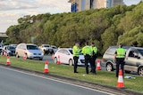 Cars wait in long queue, police speak to drivers at checkpoint