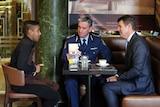 Mike Baird and Andrew Scipione meeting siege survivor Joel Herat