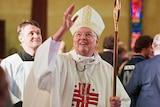 Bishop Greg O'Kelly attends a mass.