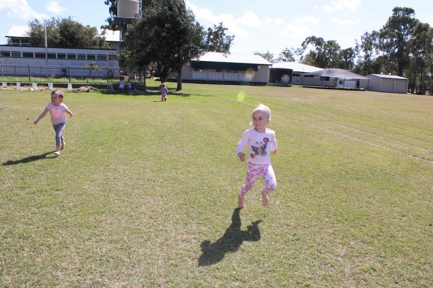 Preschooler in a running race on a school oval.