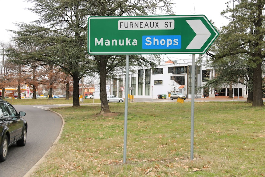 A sign directs motorists to the Manuka shops in Griffith.