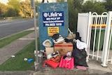 Broken items left outside charity donation bin