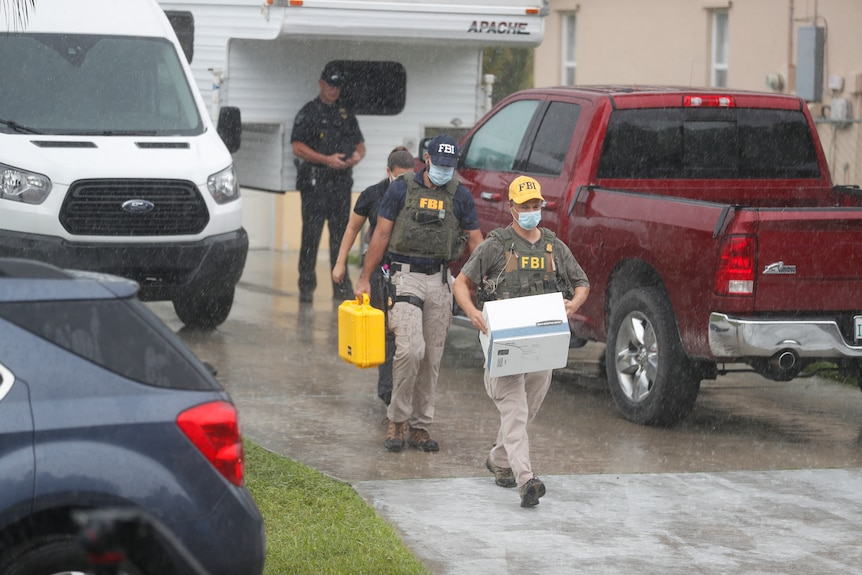 FBI agents are seen taking away boxes of evidence from the home of Brian Laundrie, Gabby Petito's fiance.