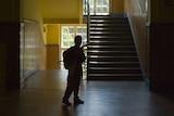Child in school hallway