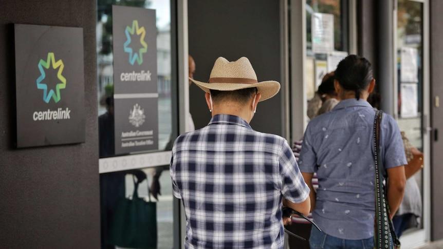 Queenslanders wait in line at Centrelink.