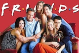 The cast of Friends against a bright red background.