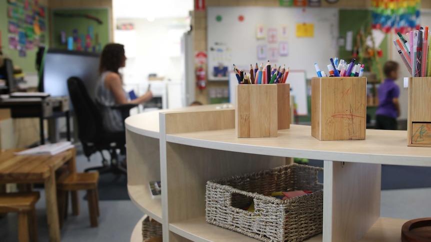 Primary school classroom with wooden shelf
