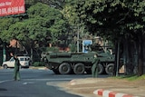 Army soldiers clear the traffic as an armoured personnel vehicle moves on a road in Yangon,Myanmar.