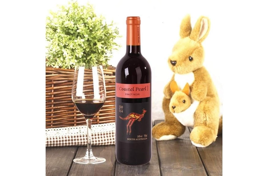 'Coastel Pearl' wine on Pinduoduo with a stuffed kangaroo. The label looks like Yellow Tails wine from Australia.