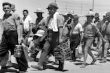 interned men walking out of prison gates